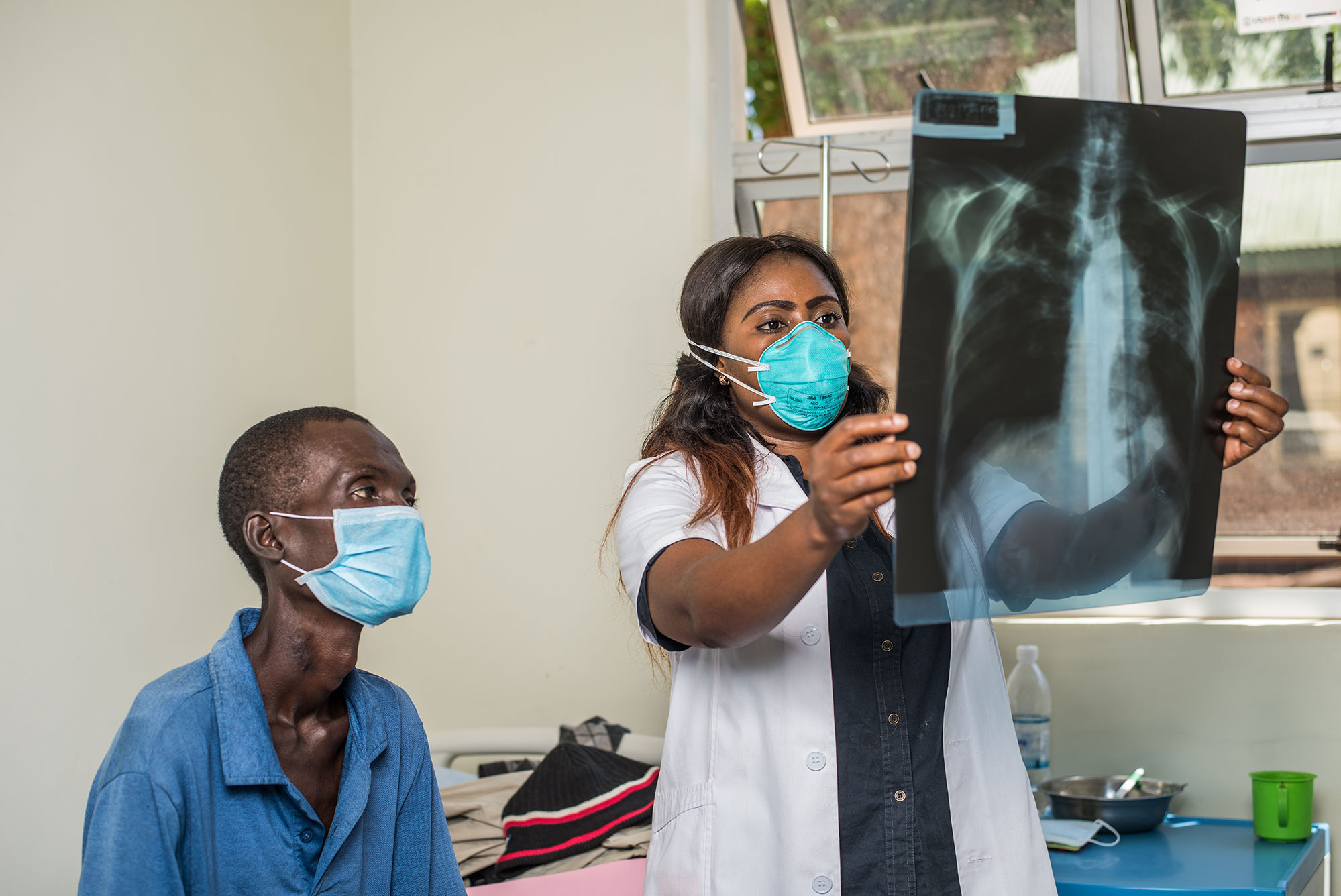 Health worker in Zambia examines x-ray